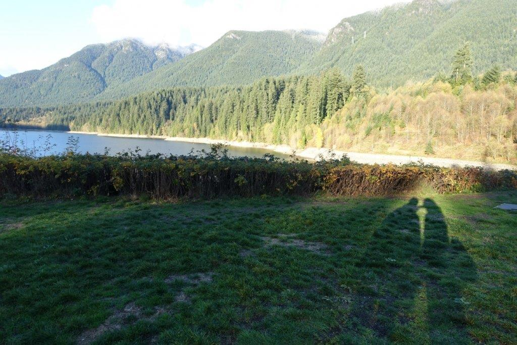 View of Capilano Lake with the silhouette of us