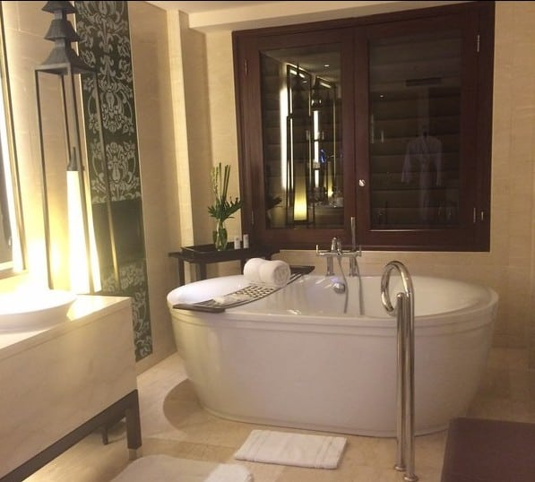 Big spacious bathroom with a huge standalone bathtub. I literally fell asleep in it 1 minute after I dipped into the bubble bath