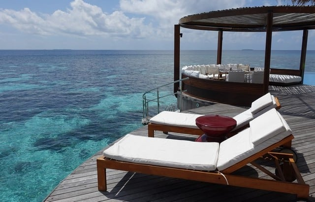 Veranda of the over water bungalow at W Maldives, overlooking the stunning coral reefs and blue clear ocean
