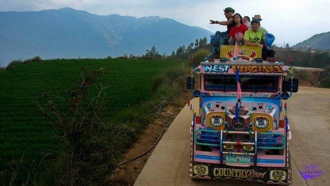 going crazy on top the jeepney on the way down the rolling hills