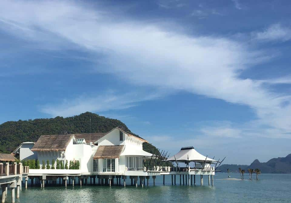 View of Kayuputi Restaurant at St Regis Langkawi Resort. Lovely over-water bungalow with a whitewash exterior and even more stunning interior.