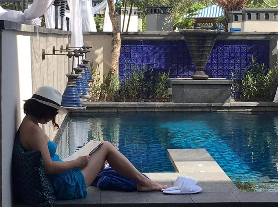 Catching up on some reading in the day by the window stile of our pool suite