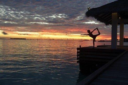 Yoga with the blazing sunset at Sheraton Maldives