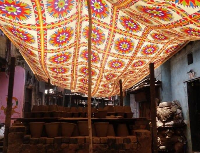 The Colours of India - Beautiful cloth covering the pots drying. Made at some of the slums.