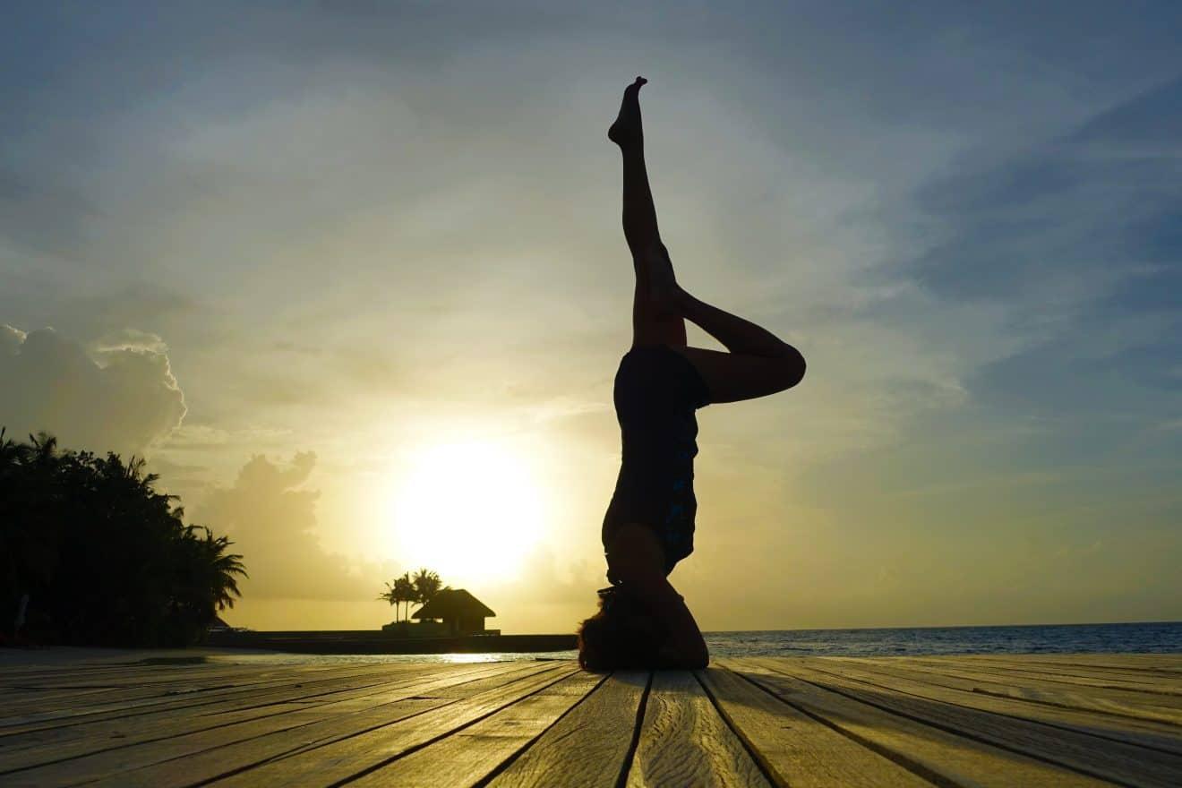 Sunset yoga poses in W Maldives