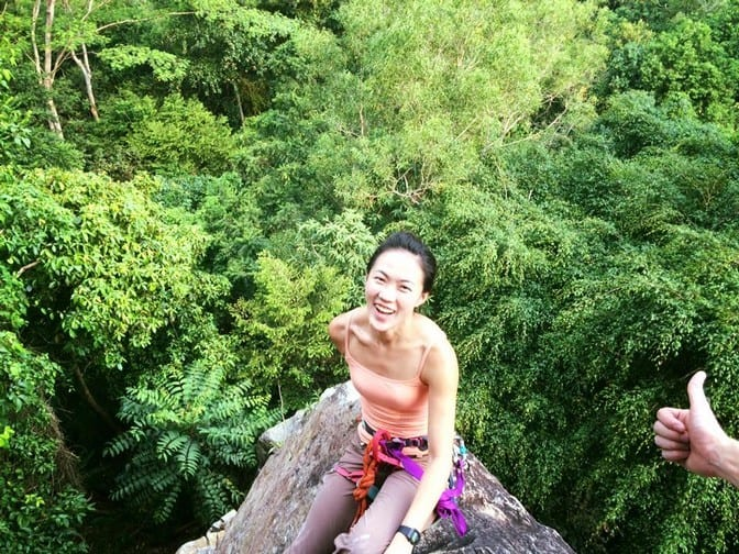 View of the forest below at one of the top anchors at Dairyfarm Singapore. The life of a female rock cliimber