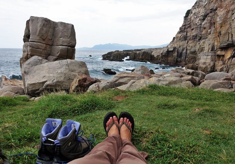Beautiful view of waves crashing against the shore while resting between climbs