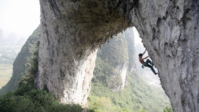 Yangshuo Grit Route at Moonhill. Photo credited to alexreshikov.com