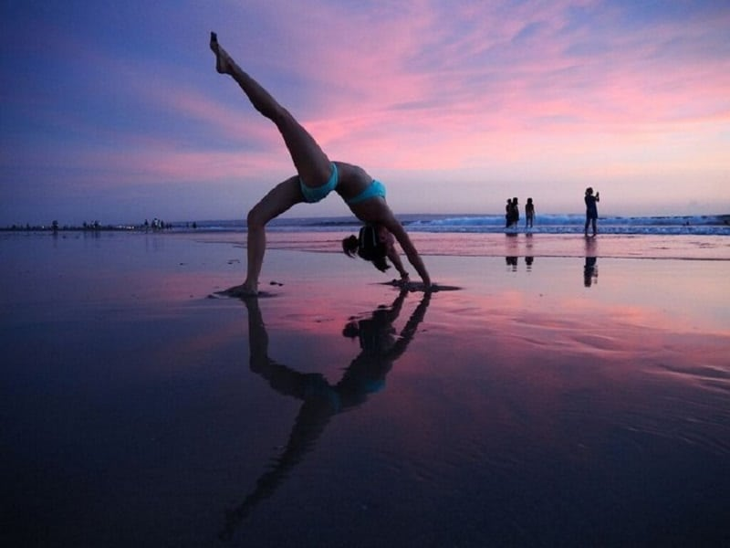 backward bend at kuta beach | Bali Holiday Traveller
