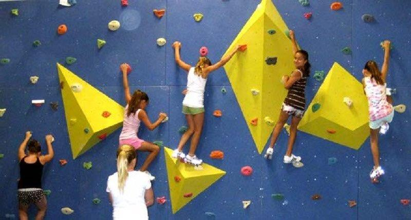 Rock Climbing for Kids - Trying out the bouldering wall. Photo credited to inflatablestartup.com