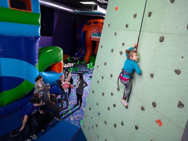 rock climbing for kids. Challenges push the kids to think. Photo credited to rockclimbinggym.net
